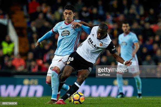 Kondogbia of Valencia CF competes for the ball with Pablo Hernandez of Real Club Celta de Vigo during the La Liga game between Valencia CF and Real...