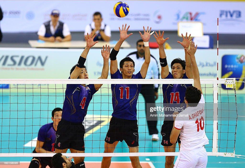 Kondoh Shigeru (L) and Matsumoto Yoshihhikc and Fukuzawa Tatsuya during 17th Asian Men's Volleyball Championship between Iran And Japan on October 5, 2013 in Dubai, United Arab Emirates.