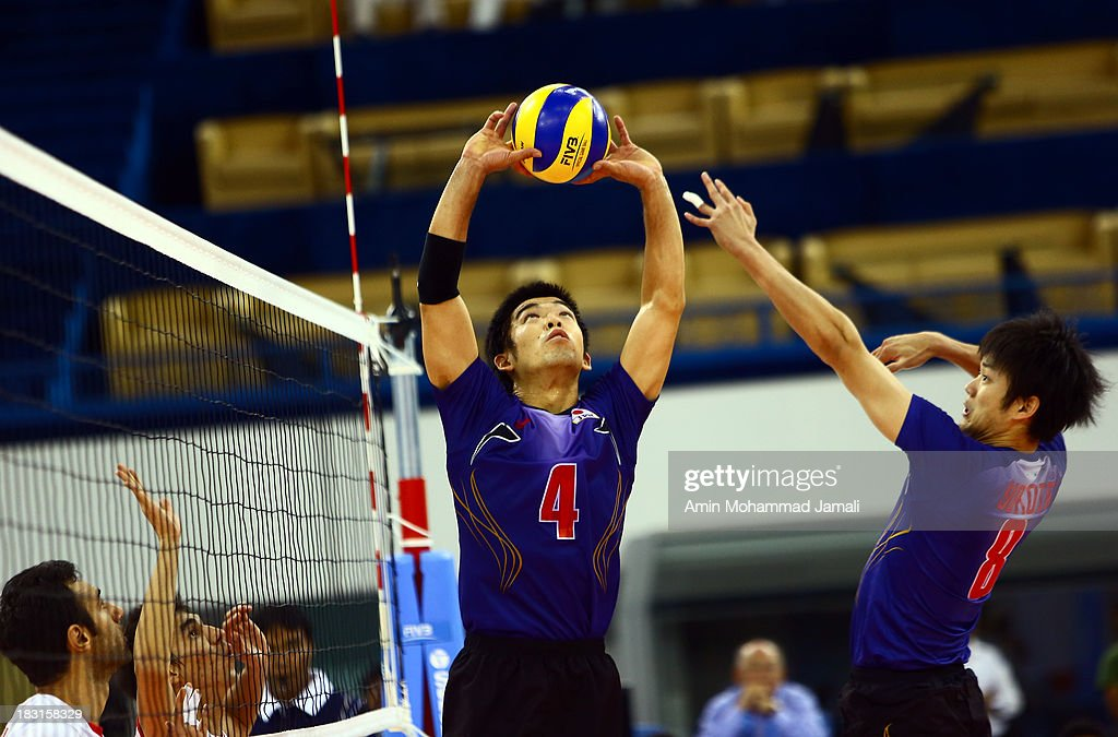 Kondoh Shigeru (L) and Yokota Kazuyoshi during the 17th Asian Men's Volleyball Championship between Iran And Japan on October 5, 2013 in Dubai, United Arab Emirates.