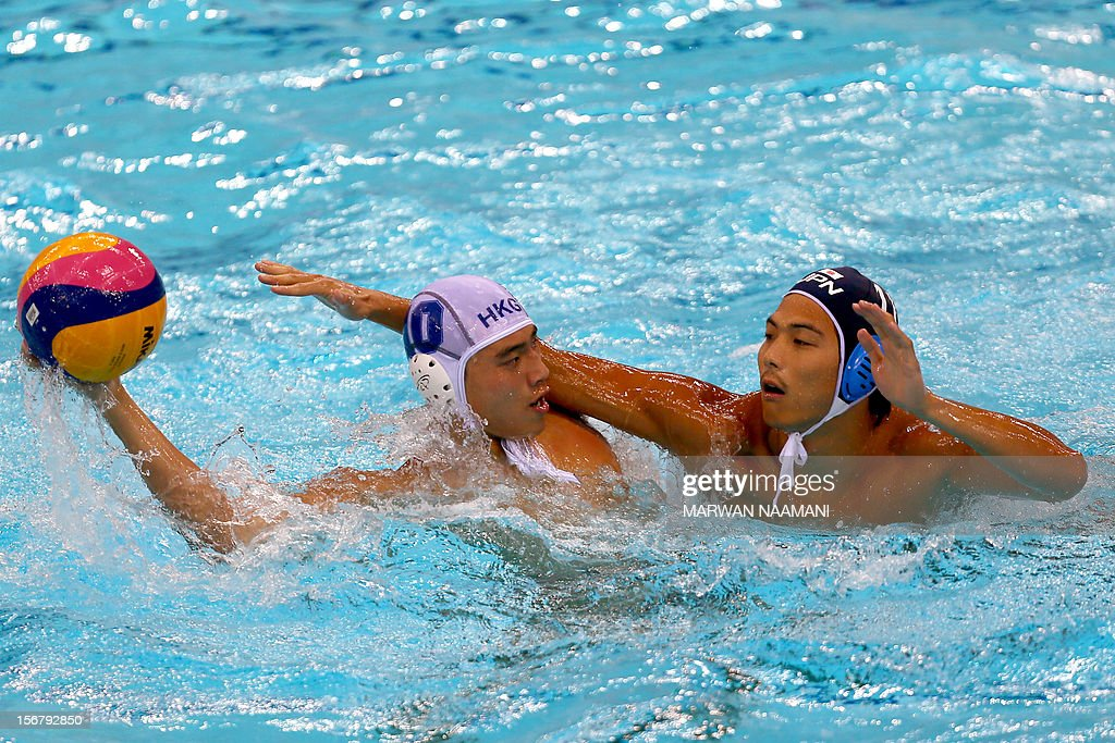 Kong Ching Fung (L) of Hong Kong vies for the ball against Kenya Yasuda of Japan tries during the two teams water polo game in at the 9th Asian Swimming Championships in Dubai, on November 21, 2012.