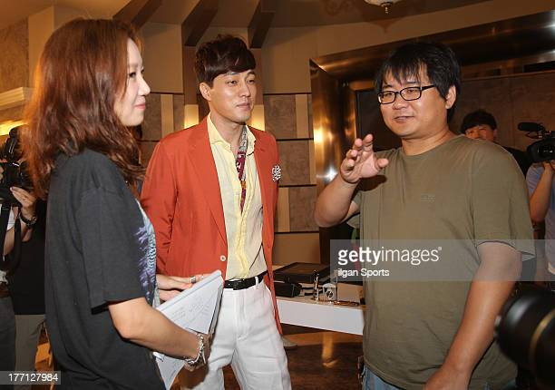Kong HyoJin So JiSub and director Jin Hyuk are seen during the SBS Drama 'The Master's Sun' filming at SBS Ilsan Production Center on August 2 2013...