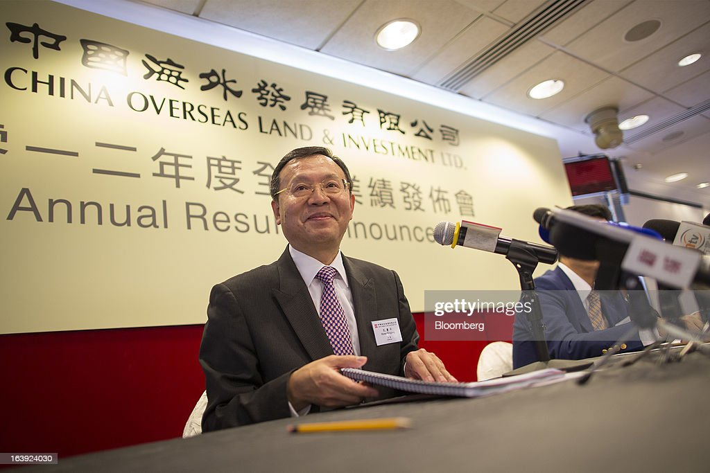 Kong Qingping, chairman of China Overseas Land & Investment Ltd., attends a news conference in Hong Kong, China, on Monday, March 18, 2013. China Overseas Land & Investment Ltd., the country's biggest developer by market value listed in Hong Kong, said 2012 profit climbed 21 percent on gains from property revaluations and the sales of stakes in some projects. Photographer: Jerome Favre/Bloomberg via Getty Images