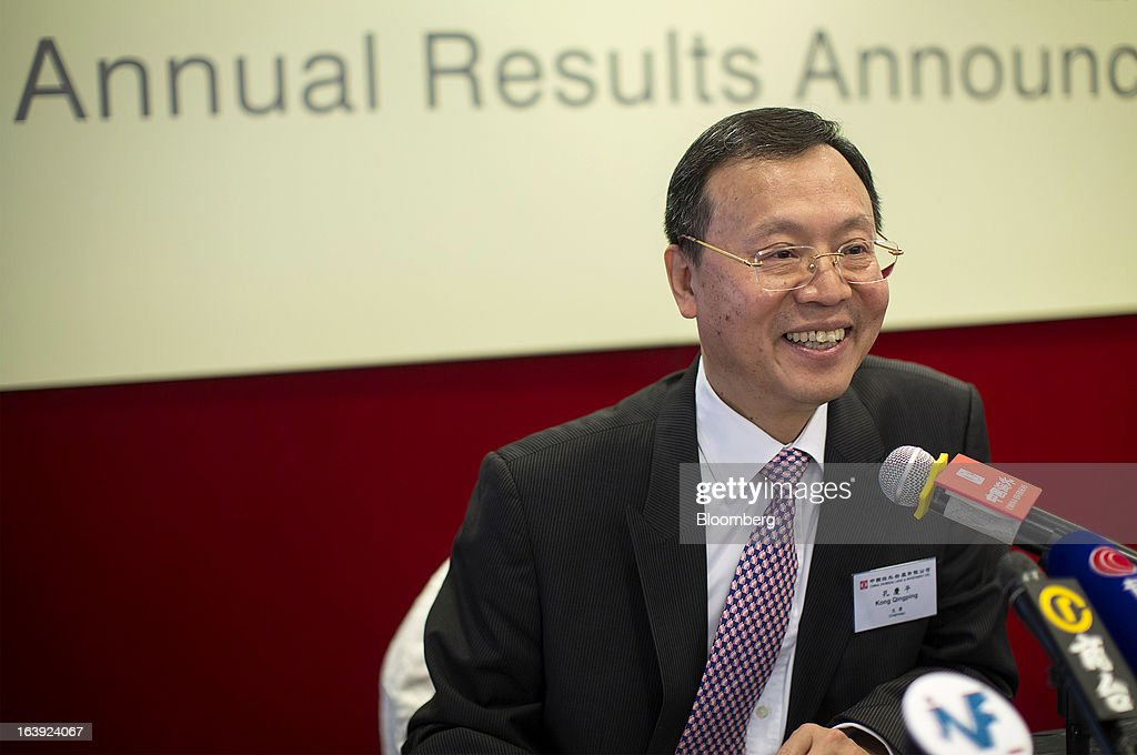 Kong Qingping, chairman of China Overseas Land & Investment Ltd., reacts during a news conference in Hong Kong, China, on Monday, March 18, 2013. China Overseas Land & Investment Ltd., the country's biggest developer by market value listed in Hong Kong, said 2012 profit climbed 21 percent on gains from property revaluations and the sales of stakes in some projects. Photographer: Jerome Favre/Bloomberg via Getty Images
