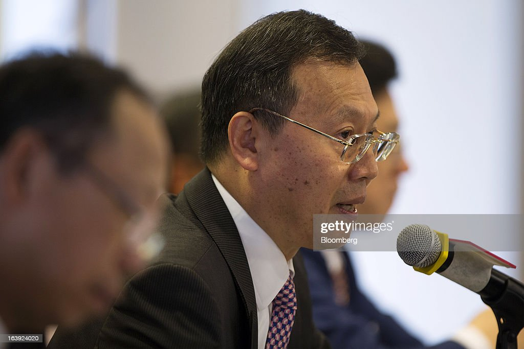 Kong Qingping, chairman of China Overseas Land & Investment Ltd., speaks during a news conference in Hong Kong, China, on Monday, March 18, 2013. China Overseas Land & Investment Ltd., the country's biggest developer by market value listed in Hong Kong, said 2012 profit climbed 21 percent on gains from property revaluations and the sales of stakes in some projects. Photographer: Jerome Favre/Bloomberg via Getty Images