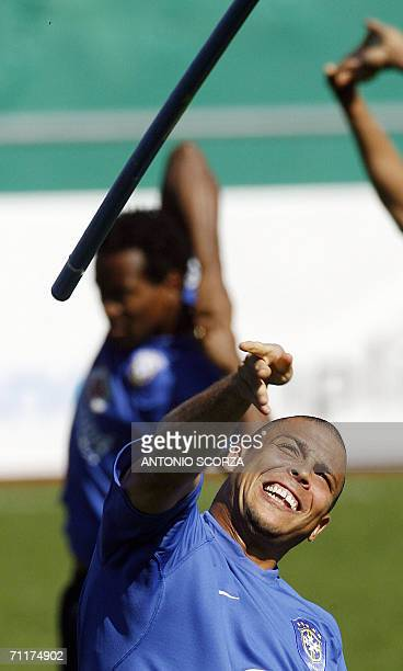 Brazilian striker Ronaldo throws a mark like a dart 10 June 2006 during a training session at the Zagallo Arena in Konigstein Germany Brazil's World...