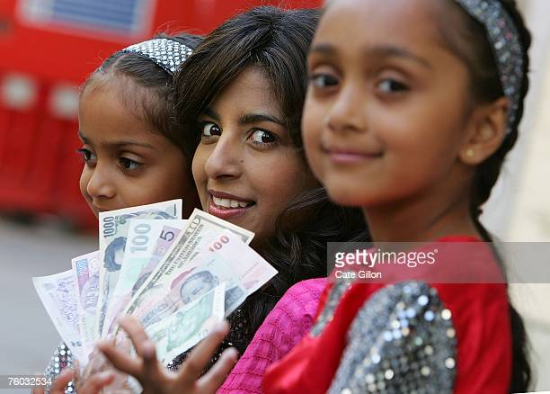 Konnie Huq promotes a Global Cash Transfer Service offered by the Post Office on August 9 2007 in London England All 14000 Post Office branches are...