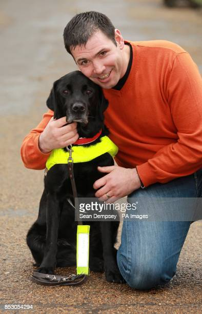 Konrad GalenBisping from Carmarthenshire with his Labrador Radley at the announcement of the finalists of the Crufts dog hero competition at Green...