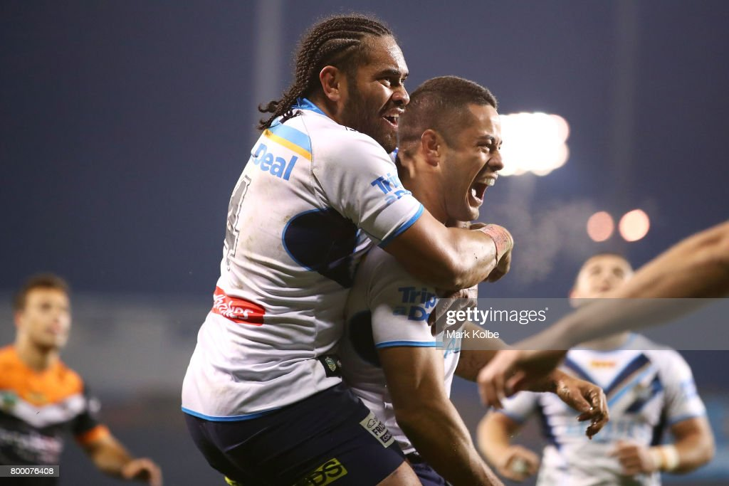 Konrad Hurrell and Jarryd Hayne of the Titans celebrate Hayne scoring a try during the round 16 NRL match between the Wests Tigers and the Gold Coast Titans at Campbelltown Sports Stadium on June 23, 2017 in Sydney, Australia.