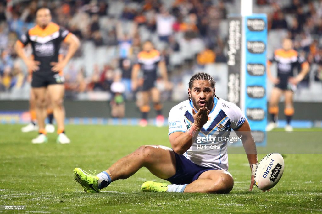 Konrad Hurrell of the Titans blows a kiss as he celebrates scoring a try during the round 16 NRL match between the Wests Tigers and the Gold Coast Titans at Campbelltown Sports Stadium on June 23, 2017 in Sydney, Australia.