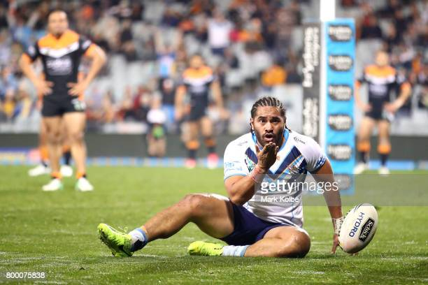 Konrad Hurrell of the Titans blows a kiss as he celebrates scoring a try during the round 16 NRL match between the Wests Tigers and the Gold Coast...