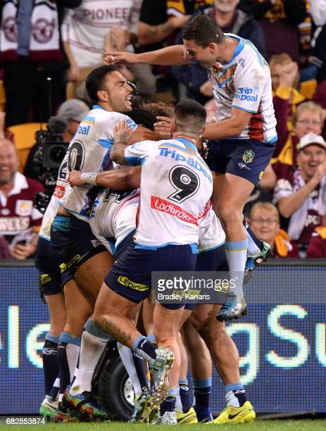 Konrad Hurrell of the Titans is congratulated by team mates after scoring a try during the round 10 NRL match between the Melbourne Storm and the...