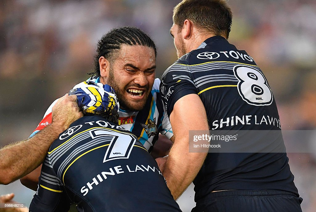 Konrad Hurrell of the Titans is tackled by Johnathan Thurston and Scott Bolton of the Cowboys during the round 26 NRL match between the North Queensland Cowboys and the Gold Coast Titans at 1300SMILES Stadium on September 3, 2016 in Townsville, Australia.