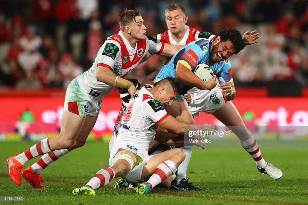 Konrad Hurrell of the Titans is tackled during the round 19 NRL match between the St George Illawarra Dragons and the Gold Coast Titans at WIN Jubilee Stadium on July 15, 2016 in Sydney, Australia.