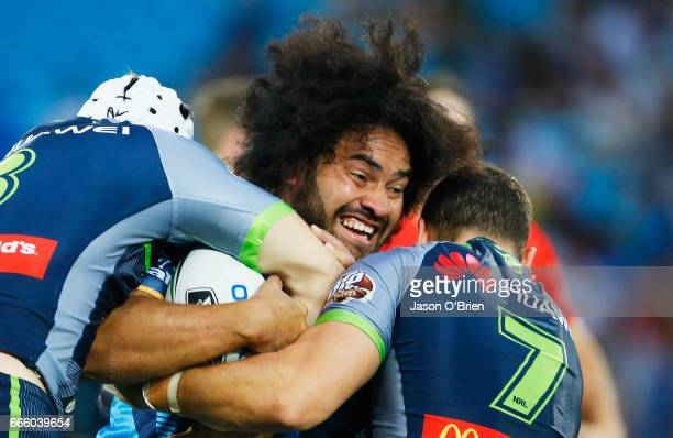 Konrad Hurrell of the Titans is tackled during the round six NRL match between the Gold Coast Titans and the Canberra Raiders at Cbus Super Stadium...