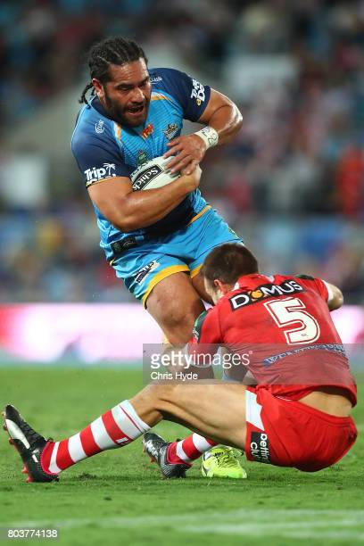 Konrad Hurrell of the Titans makes a break during the round 17 NRL match between the Gold Coast Titans and the St George Illawarra Dragons at Cbus...