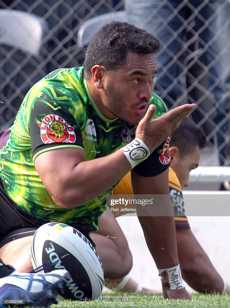 Konrad Hurrell of the Warriors celebrates his try during the NRL trial match between the Brisbane Broncos and the New Zealand Warriors at Forsyth Barr Stadium on February 23, 2014 in Dunedin, New Zealand.