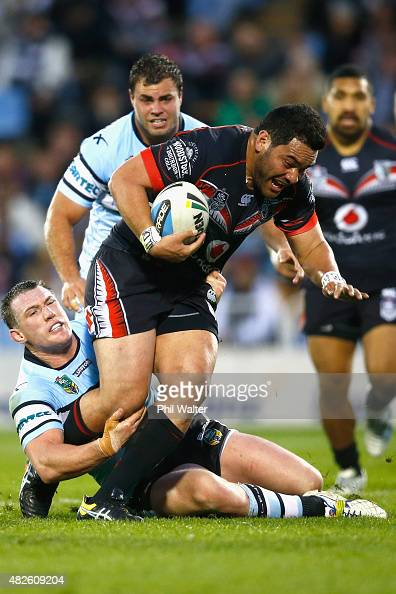 Konrad Hurrell of the Warriors is tackled by Paul Gallen of the Sharks during the round 21 NRL match between the New Zealand Warriors and the...