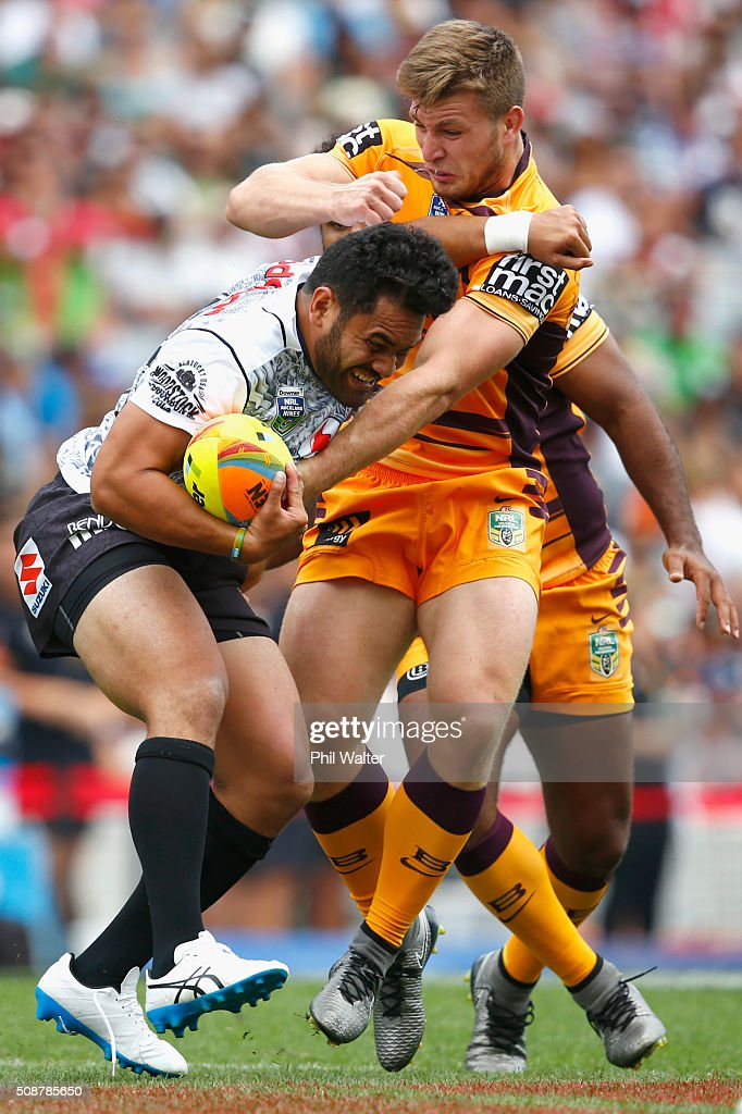 <a gi-track='captionPersonalityLinkClicked' href=/galleries/search?phrase=Konrad+Hurrell&family=editorial&specificpeople=8308514 ng-click='$event.stopPropagation()'>Konrad Hurrell</a> of the Warriors is tackled during the 2016 Auckland Nines match between the New Zealand Warriors and the Brisbane Broncos at Eden Park on February 7, 2016 in Auckland, New Zealand.