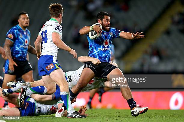 Konrad Hurrell of the Warriors is tackled during the round nine NRL match between the New Zealand Warriors and the Canberra Raiders at Eden Park on...