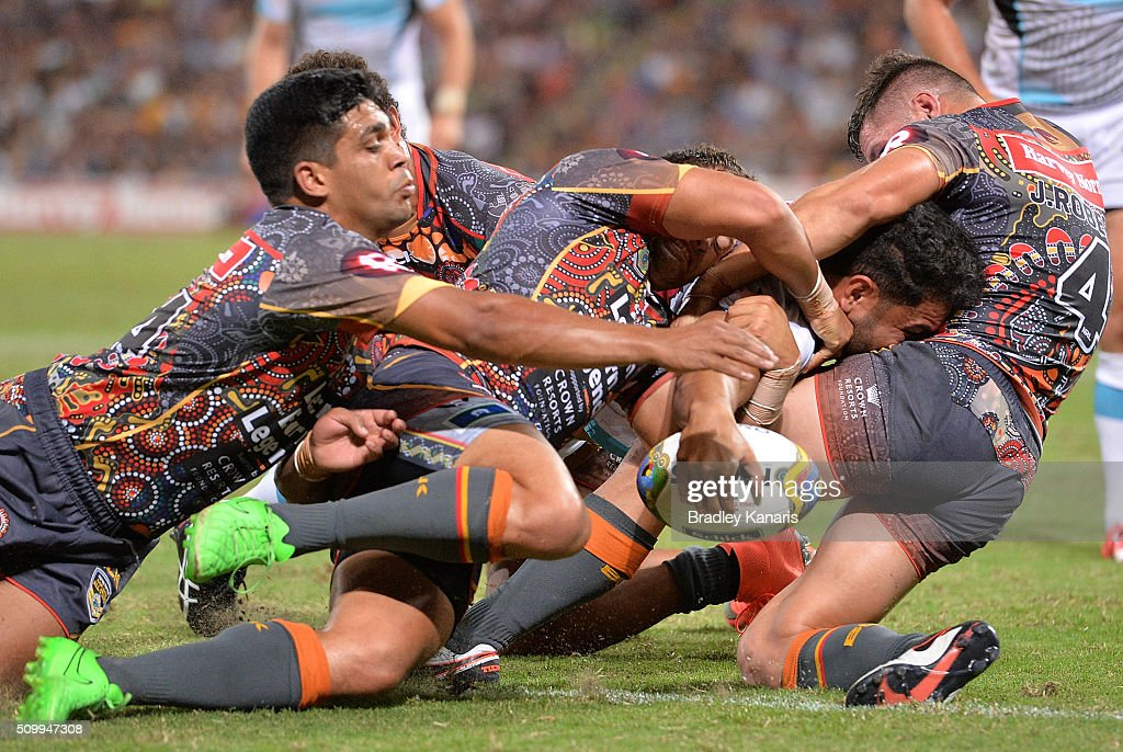 <a gi-track='captionPersonalityLinkClicked' href=/galleries/search?phrase=Konrad+Hurrell&family=editorial&specificpeople=8308514 ng-click='$event.stopPropagation()'>Konrad Hurrell</a> of the World All Stars fights through the defence to score a try during the NRL match between the Indigenous All-Stars and the World All-Stars at Suncorp Stadium on February 13, 2016 in Brisbane, Australia.