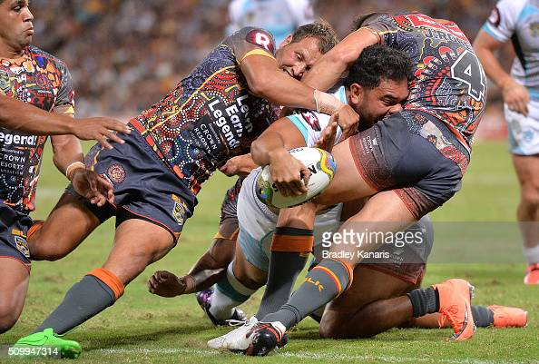 Konrad Hurrell of the World All Stars fights through the defence to score a try during the NRL match between the Indigenous AllStars and the World...