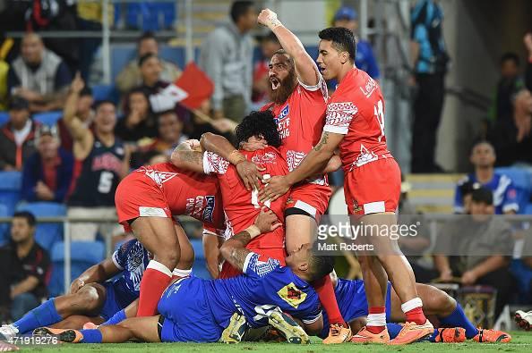 Konrad Hurrell of Tonga celebrates with try scorer Sika Manu during the International Test Match between TOA Samoa and Tonga at Cbus Super Stadium on...