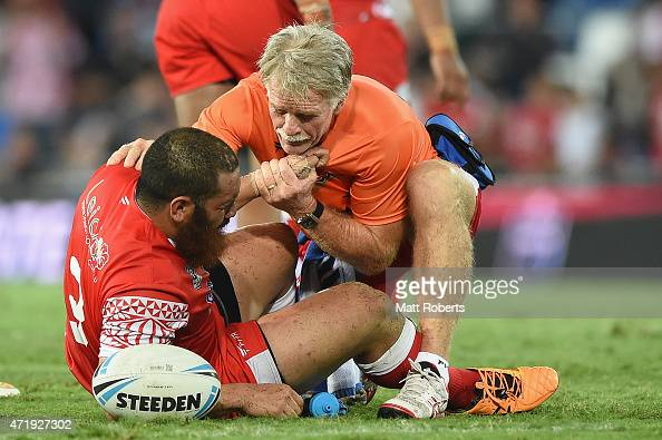 Konrad Hurrell of Tonga receives attention from a trainer on the field during the International Test Match between TOA Samoa and Tonga at Cbus Super...