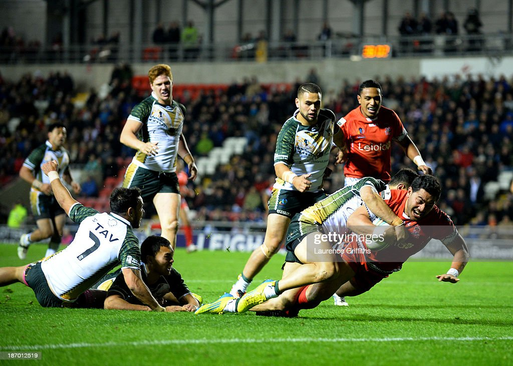 Konrad Hurrell of Tonga scores a first half try during the Rugby League World Cup GroupC/D match between Tonga and Cook Islands at Leigh Sports Village on November 5, 2013 in Leigh, Greater Manchester.