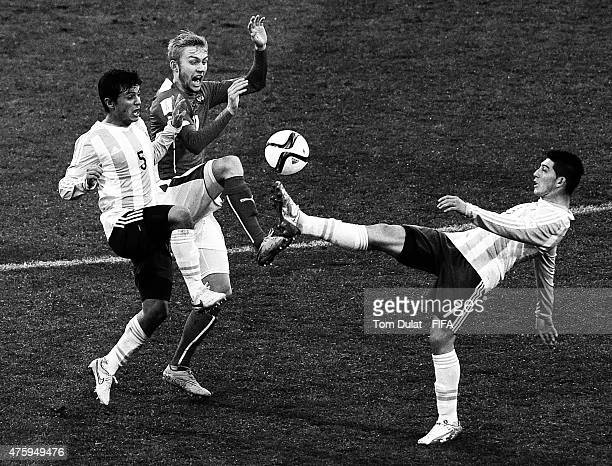 Konrad Laimer of Austria battles for the ball with Adrian Cubas and Cristian Espinoza of Argentina during the FIFA U20 World Cup New Zealand 2015...