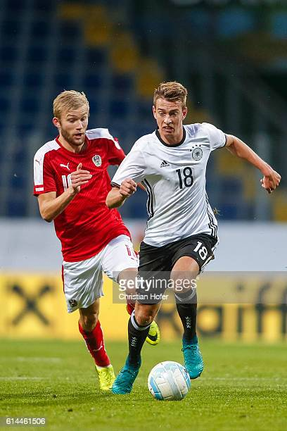 Konrad Laimer of Austria challenges Janik Haberer of Germany for the ball during the 2017 UEFA European U21 Championships Qualifier between U21...