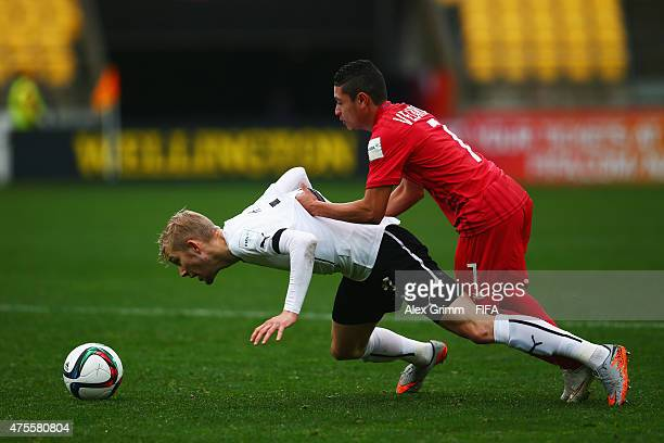 Konrad Laimer of Austria is challenged by Julian Velarde of Panama during the FIFA U20 World Cup New Zealand 2015 Group B match between Austria and...