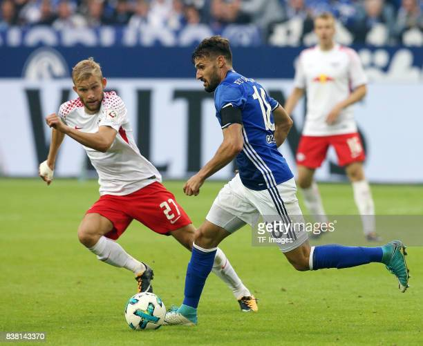 Konrad Laimer of Leipzig and Daniel Caligiuri of Schalke battle for the ball during the Bundesliga match between FC Schalke 04 and RB Leipzig at...