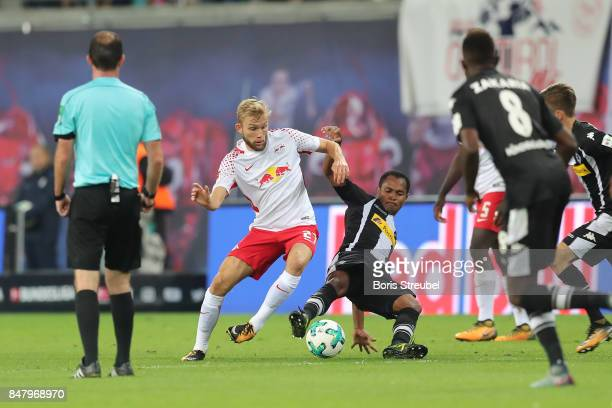 Konrad Laimer of Leipzig fights for the ball with Raffael of Moenchengladbach during the Bundesliga match between RB Leipzig and Borussia...