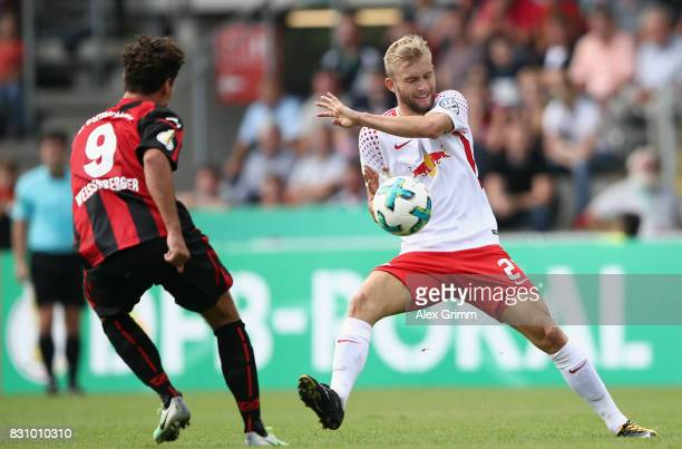 Konrad Laimer of Leipzig is challenged by Niklas Weissenberger of Dorfmerkingen during the DFB Cup first round match between Sportfreunde...