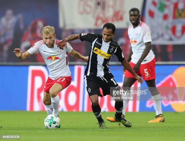 Konrad Laimer of RB Leipzig battles for the ball with Raffael of Borussia Moenchengladbach during the Bundesliga match between RB Leipzig and...