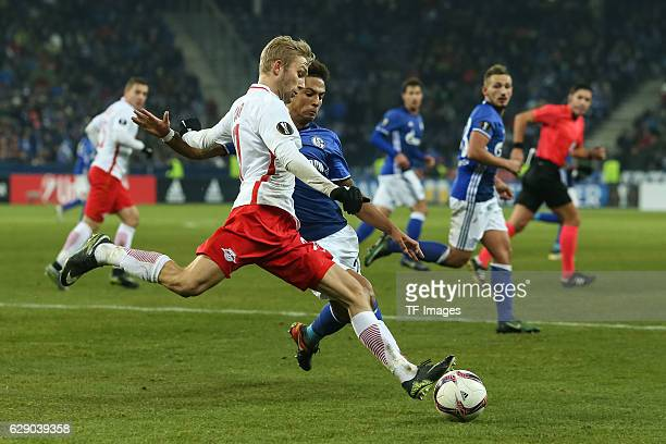 Konrad Laimer of Salzburg and Thilo Kehrer of Schalke battle for the ball during the UEFA Europa League match between FC Salzburg and FC Schalke 04...