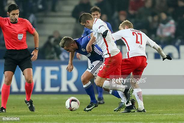 Konrad Laimer of Salzburg Josip Radosevic of Salzburg and Donis Avdijaj of Schalke battle for the ball during the UEFA Europa League match between FC...
