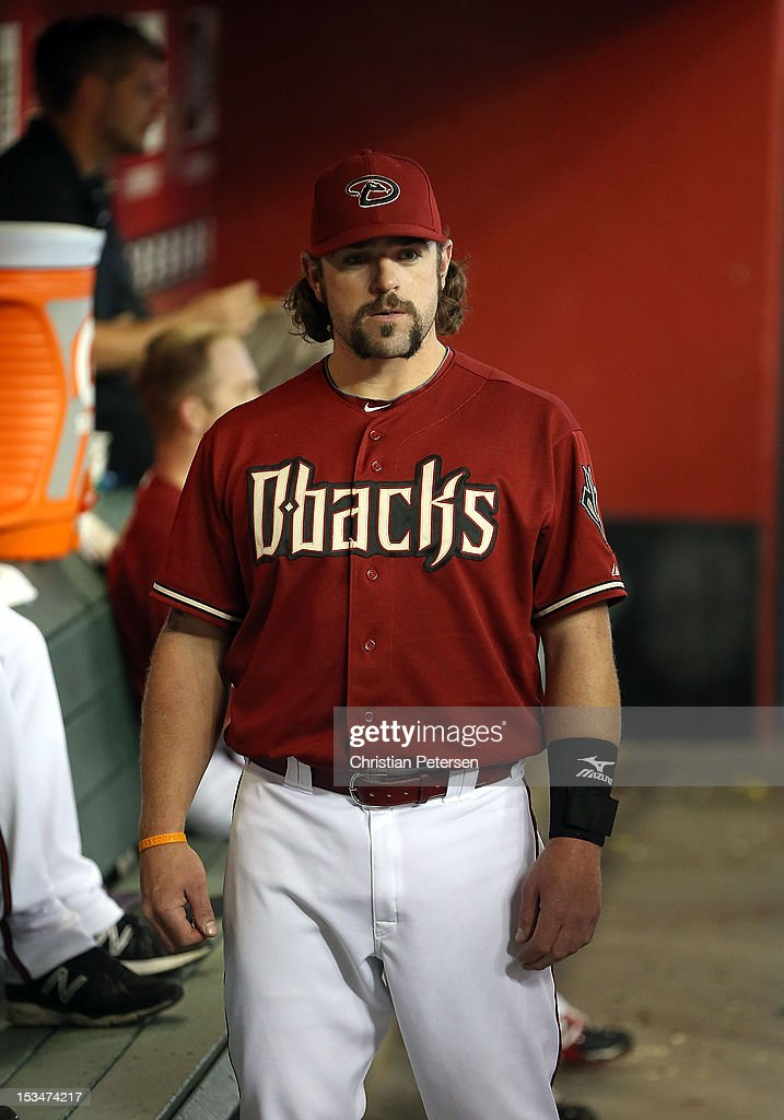 Konrad Schmidt #33 of the Arizona Diamondbacks in the dugout during the MLB game against the Colorado Rockies at Chase Field on October 3, 2012 in Phoenix, Arizona.