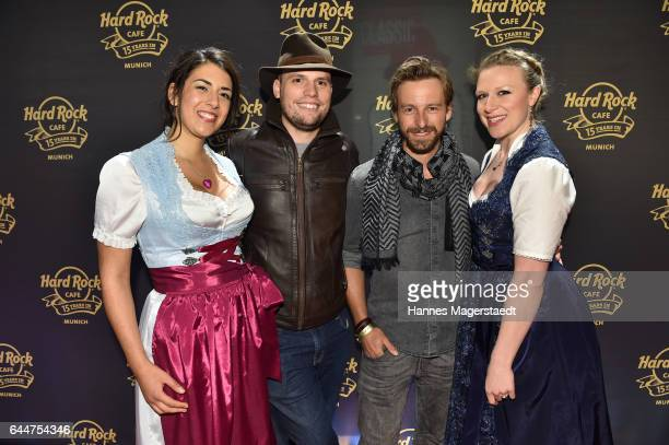 Konrad Simon and Benedikt Blaskovic with models during the 15th anniversary celebration of the Hard Rock Cafe Munich on February 23 2017 in Munich...