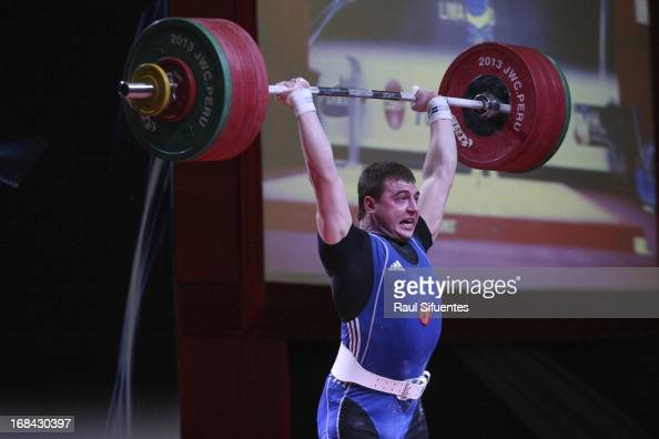 Konstanti Roschupkin of Russia A competes in Men's 94kg during day six of the 2013 Junior Weightlifting World Championship at Maria Angola Convention...