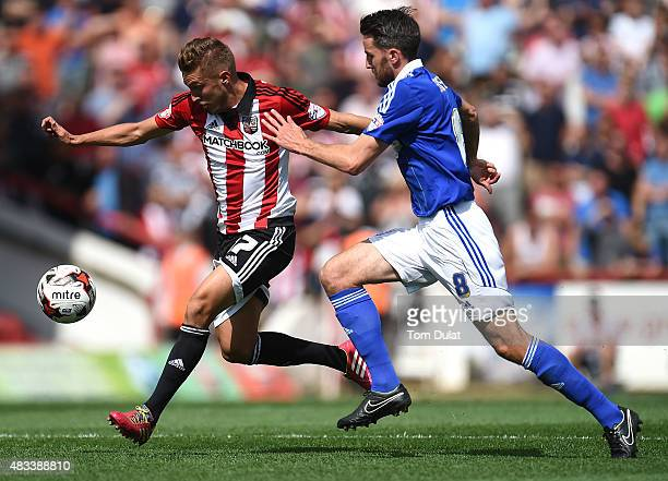 Konstantin Kerschbaumer of Brentford and Cole Skuse of Ipswich Town in action during the Sky Bet Championship match between Brentford and Ipswich...