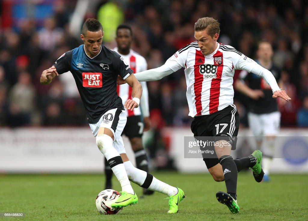 Konstantin Kerschbaumer of Brentford chases down Thomas Ince of Derby County during the Sky Bet Championship match between Brentford and Derby County at Griffin Park on April 14, 2017 in Brentford, England.