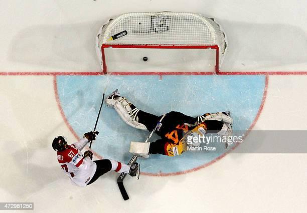 Konstantin Komarek of Austria scores a goal over Dennis Endras goaltender of Germany during the IIHF World Championship group A match between Germany...