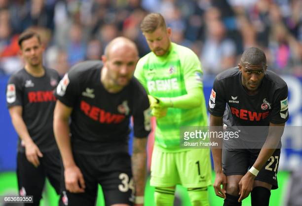 Konstantin Rausch and Anthony Modeste of Cologne look dejected during the Bundesliga match between Hamburger SV and 1 FC Koeln at Volksparkstadion on...