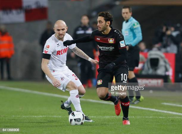 Konstantin Rausch of Cologne and Hakan Calhanoglu of Leverkusen battle for the ball during the Bundesliga soccer match between 1 FC Cologne and Bayer...