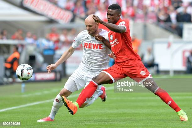 Konstantin Rausch of Colonge and Jhon Cordoba of Mainz battle for the ball during the Bundesliga Match between 1FC Koeln and1 FSV Mainz 05 at...