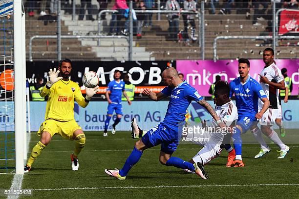 Konstantin Rausch of Darmstadt misses a chance to score against goalkeeper Ramazan Oezcan of Ingolstadt during the Bundesliga match between SV...