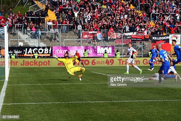 Konstantin Rausch of Darmstadt scores his team's first goal against goalkeeper Ramazan Oezcan of Ingolstadt during the Bundesliga match between SV...