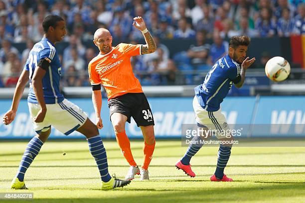 Konstantin Rausch of Darmstadt shoots on goal and scores during the Bundesliga match between FC Schalke 04 and SV Darmstadt 98 held at VeltinsArena...