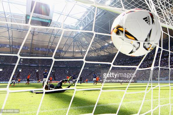 Konstantin Rausch of Darmstadt shoots on goal and scores past Goalkeeper Ralf Fahrmann of Schalke during the Bundesliga match between FC Schalke 04...